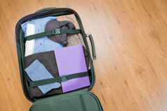 Open Suitcase Lying on the Floor Royalty Free Stock Photos