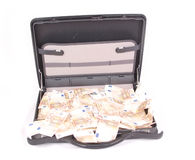 Open suitcase with money on white Stock Photo