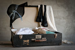 Open suitcase with old things Stock Photo