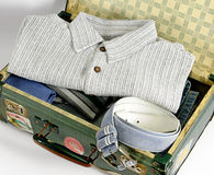 Open Suitcase Packed with Clothing Stock Photo