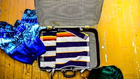 Open suitcase packed for travelling, close up stock video footage