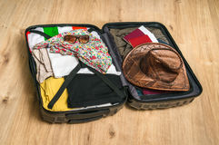 Open suitcase packed for travelling Royalty Free Stock Photography