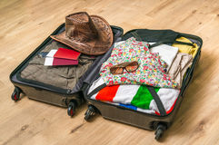 Open suitcase packed for travelling Royalty Free Stock Image