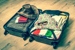 Open suitcase packed for travelling - retro style Stock Photos