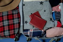 Open suitcase packed for travelling. Winter vacations and holida. Ys. Top view Stock Photo