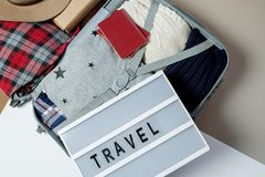 Open suitcase packed for travelling. Winter vacations and holida. Ys. Top view Royalty Free Stock Images