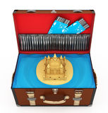 Open suitcase with sand castle and plane tickets Stock Image