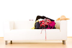 Open suitcase on settee Stock Images