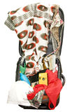 Open suitcase with things for travel. Open suitcase with camera, passport, glasses, book and clothes Royalty Free Stock Image