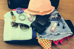 Open the suitcase with tourist things Stock Photos