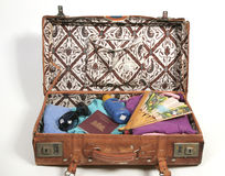 Open suitcase with vacation items stock photos