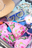 Open suitcase with vacation items Stock Image