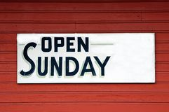 Open Sunday Sign. Photographed open Sunday sign at a store front in Georgia Stock Images