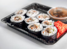 Open Sushi delivery box on white background. Angle view. Stock Photos