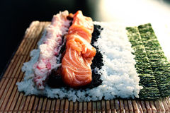 Open sushi roll with salmon, black caviar and rice Stock Image