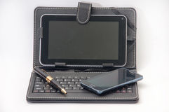 Open tablet with keyboard and Android mobile phone Royalty Free Stock Images