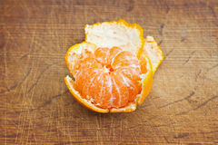 Open tangerine fruit. On the wooden background Stock Image