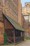 Corner of old Krakow. The open terrace of the city cafe in Krakow, is covered with ivy. The architecture of the old Polish city. It is early in the morning Royalty Free Stock Photos
