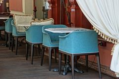 Open terrace of the restaurant with blue chairs and tables stock images