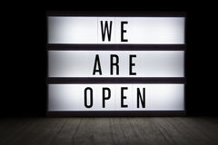 We are open. `We are open` text in lightbox stock illustration