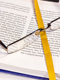 Open textbook with bookmark. And spectacles with shallow Depth of Field (DOF Stock Photos