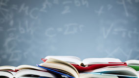 Open Textbooks with a Background of Formulas royalty free stock photos