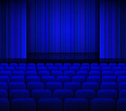 Open theater blue curtains with light and seats. Royalty Free Stock Photography