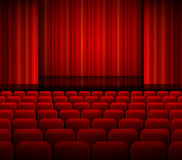 Open theater red curtains with light and seats. Royalty Free Stock Photo