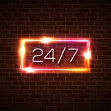 Open time 24 7 hours neon light sign on brick wall. Open 24 7 hours neon light sign on brick background. 24 hours night club bar neon sign on street wall. Red Stock Photo