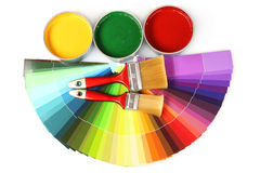Open tin cans with paint and brushes Royalty Free Stock Photography