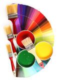 Open tin cans with paint and brushes royalty free stock images