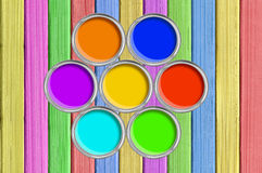 Open tin cans with paint on painted color wooden texture Stock Image