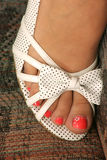 Open toe shoe. Her pink toe nail polish shows threw her open toe shoe Stock Image