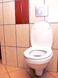 Open toilet. Ceramic toilet with open cover in a modern bathroom with tiles on the wall and floor Stock Photography