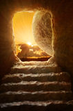 Open Tomb of Jesus. With sun appearing through entrance - Shallow depth of field on stone royalty free stock images