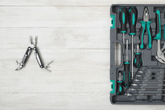 Open Toolbox And Multi Tool On Wooden Surface Royalty Free Stock Images