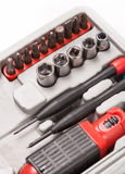 Open toolbox with screwdriver, heads and bit Stock Photography