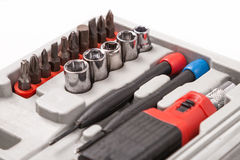 Open toolbox with screwdriver, heads and bit Royalty Free Stock Images