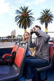Open top bus couple Royalty Free Stock Photography