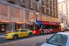 Open top sightseeing tour bus at downtown street Stock Images