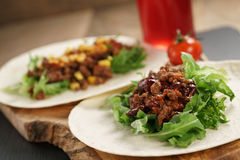 Open tortilla with beef, frillice, beans and corn Stock Images