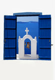 Open traditional Greek blue window on Santorini island Royalty Free Stock Images