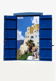 Open traditional Greek blue window on Santorini island Royalty Free Stock Photos