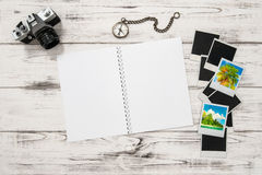 Open travel book, photo camera, holidays pictures and frames Stock Images
