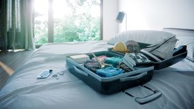 Open travel case in hotel bedroom travel vacation concept background Royalty Free Stock Image