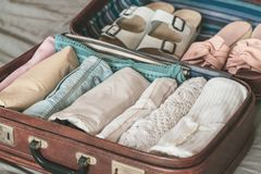 Open traveler`s bag with clothing, accessories and passport royalty free stock photography