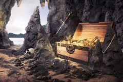 Open treasure chest with bright gold in a cave. Photo of open treasure chest with shinny gold in a cave stock photo