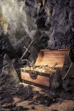 Open treasure chest with bright gold in a cave. Photo of open treasure chest with shinny gold in a cave stock photos
