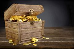 Open treasure chest filled with gold coins. Abundance adventure ancient antique background box stock images