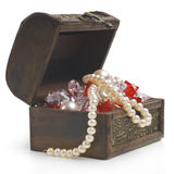 Open treasure chest with jewelry. Isolated on white Stock Photo
